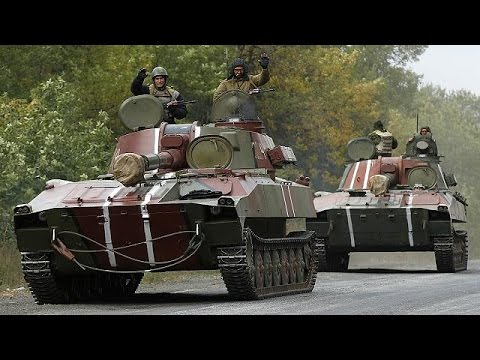 Ukrainian army and rebel troops pull back to create buffer zone