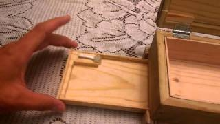 Wooden box with secret tray underneath.