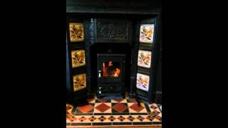 Hobbit wood burner from Salamander Stoves into Victorian Fireplace