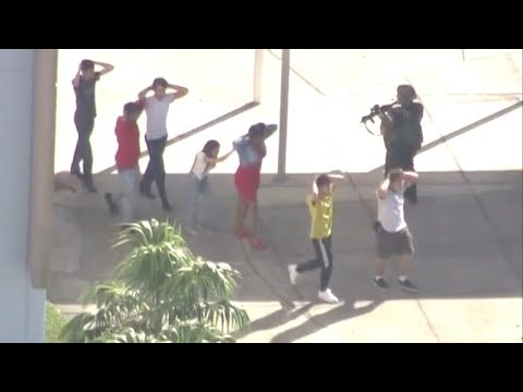 Police respond to active shooter at high school in Parkland, Florida