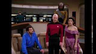 Captain Picard saves Lwaxana Troi from the Ferengi