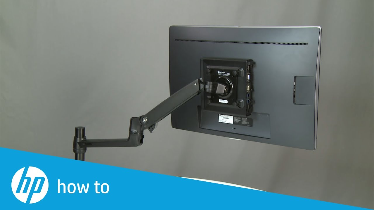 Hp Desktop Mini Mounted To A Monitor Arm And An Hp Display