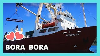 BORA BORA, cargo ship docking on a WW2 built wharf (PACIFIC OCEAN)