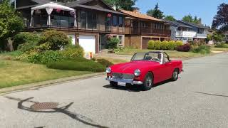 "6'6"" Man Driving 1966 MG Midget"