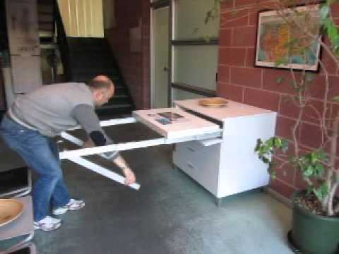 Folding away a pull out kitchen table frame - YouTube