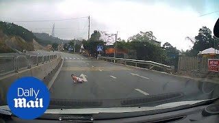 Baby saved while crossing busy road by samaritan in Vietnam - Daily Mail