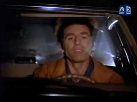 Seinfeld Kramer driving his car and listening to music
