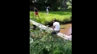 Guy Falls On A Tree Log Taking A Nut Shot While Crossing The River On His Bike