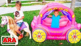 فلاد ونيكيتا يلعبان مع عربة الأميرة