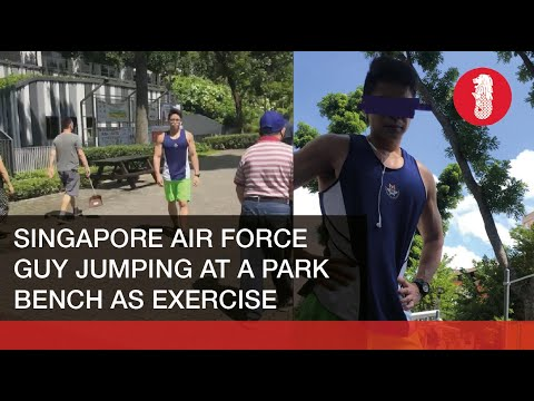 Inconsiderate Singapore Air Force guy jumps up and down at a park table as exercise