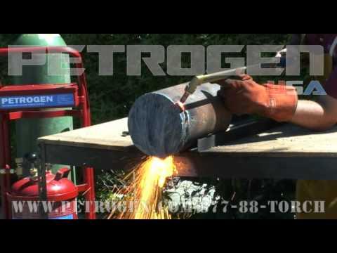 Petrogen oxy gasoline cutting torch cuts a 12 inch steel shaft.wmv