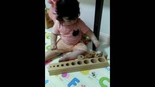 Toddler with Montessori toy 18 months old