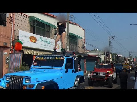 The Funeral Procession with 50 Pole Dancers?!