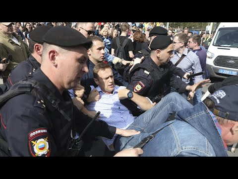Alexei Navalny and scores more arrested at anti-Putin rally