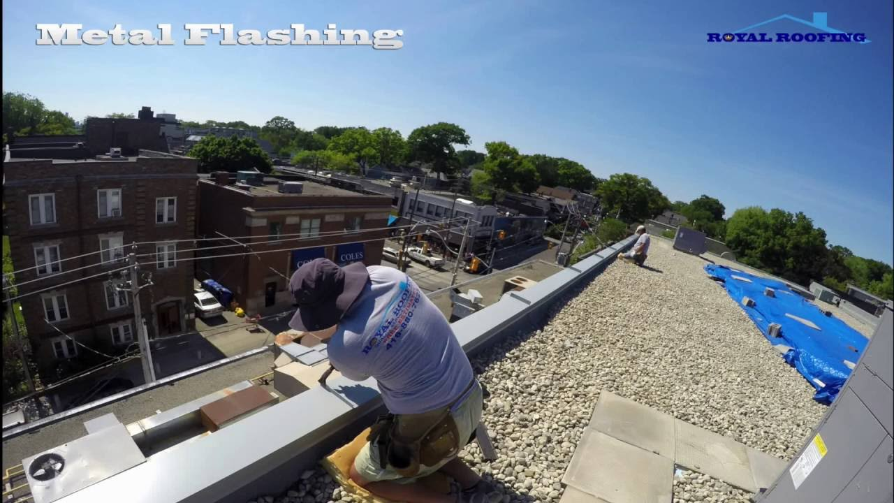Metal Flashing On Commercial Flat Roof In Down Town Of