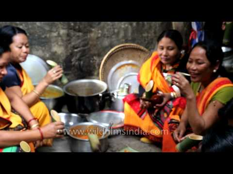 Spirit of festival enhanced by country beer and Kachari delicacies