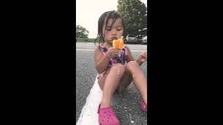 Kid eating melting ice cream