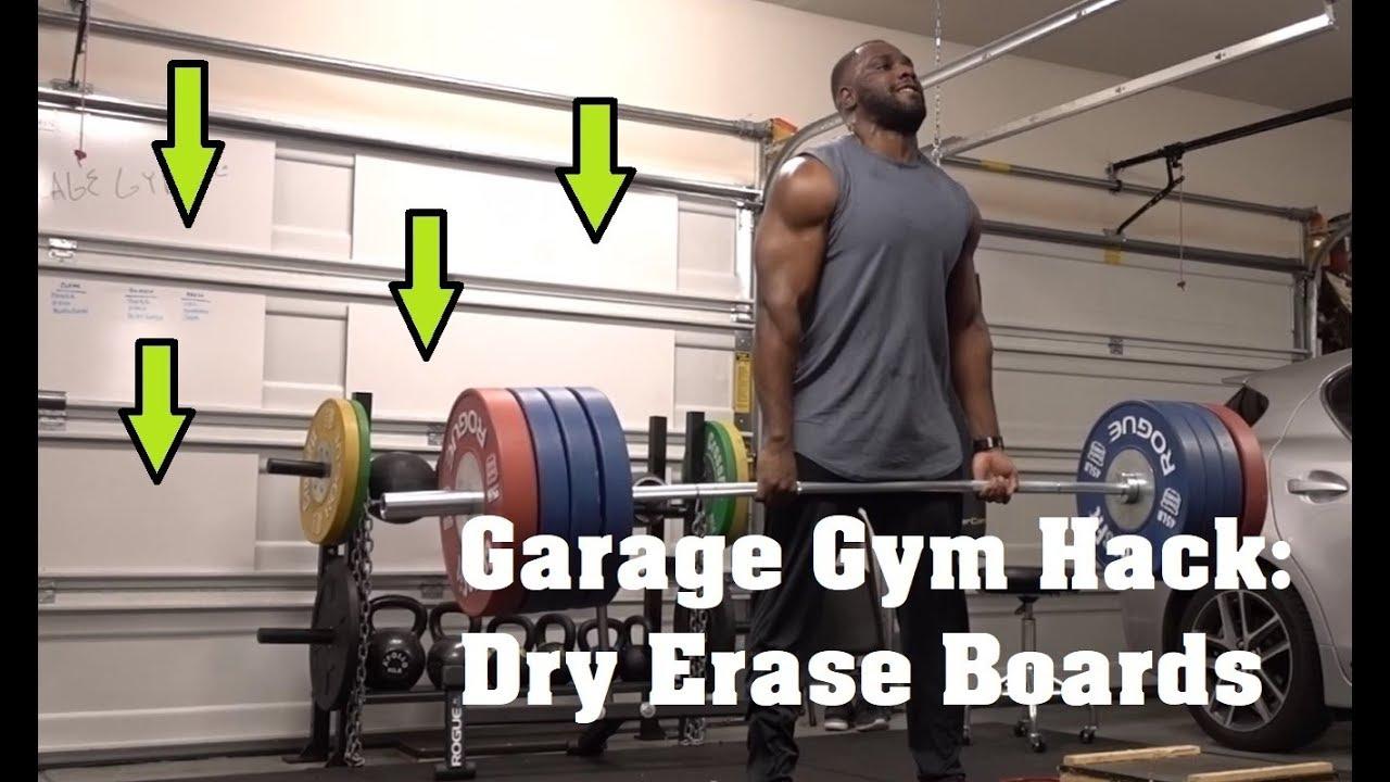 Dry erase boards on the garage gym door block pulls with kyle
