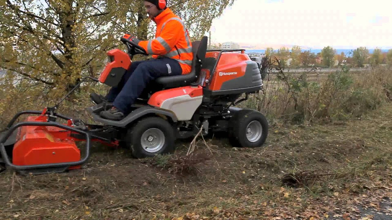 Husqvarna P 524 with flail mower in action