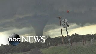 Reported 18 Tornadoes Tear Through Midwest