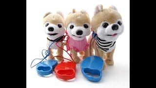 Игрушечная собака на поводке. Toy dog on a leash.