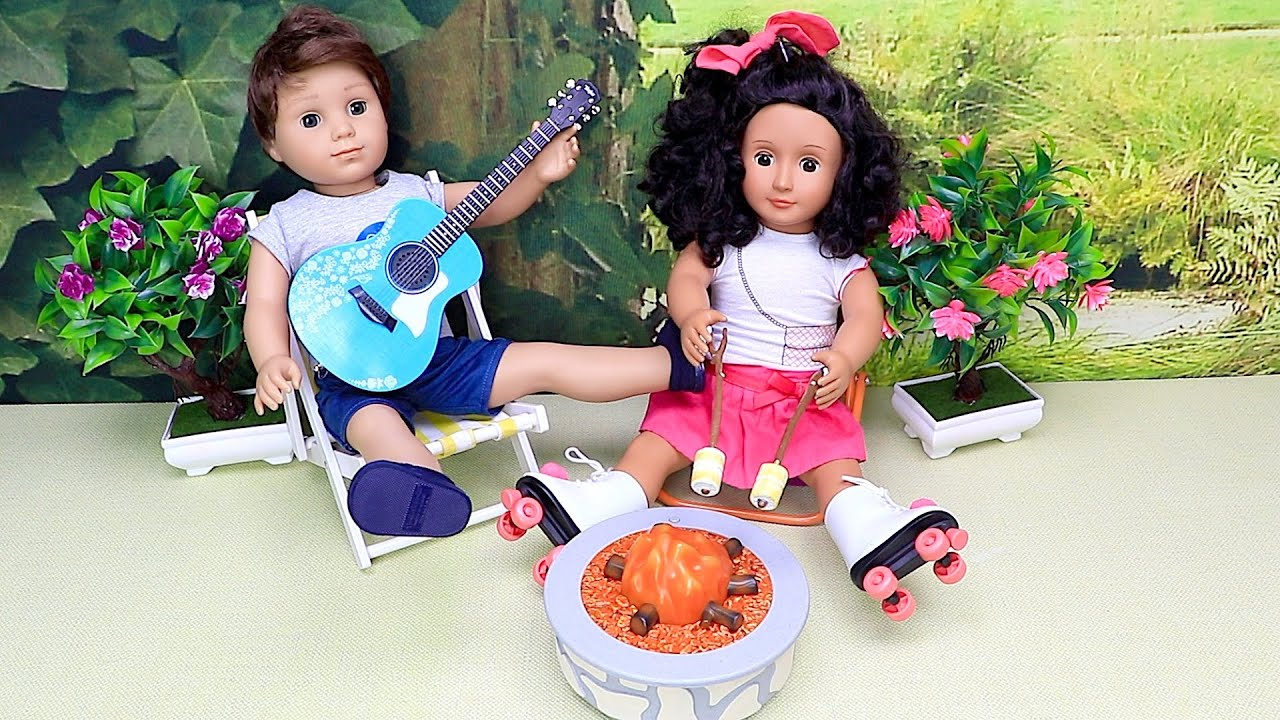 Brother and sister dolls play fun outdoor games with picnic