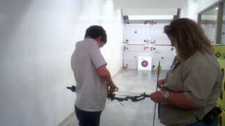 Hunter Shooting A Compound Bow.3gp