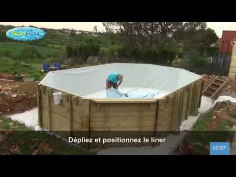 Pose liner piscine bois sunbay youtube for Pose margelle bois piscine