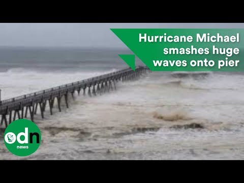 Large waves batter pier at Navarre Beach as Hurricane Michael approaches Florida