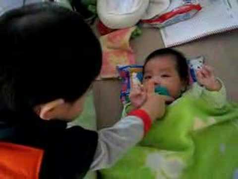 Ryan feeding Anson his pacifier