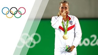 Puig wins tennis gold for Puerto Rico