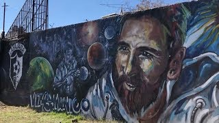 Artists make football graffiti in Messi's hometown to celebrate the World Cup