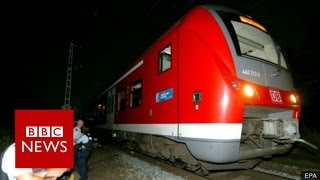 German train attack: Afghan refugee 'had IS flag in room' - BBC News