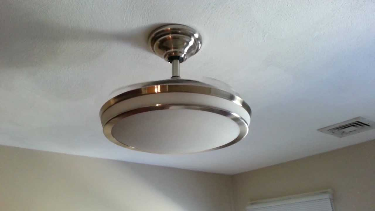 Ceiling fan with retractable blades