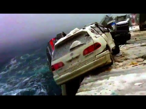 SEA STORM throws CARS vehicles trucks during WILD TYPHOON huricane WEATHER