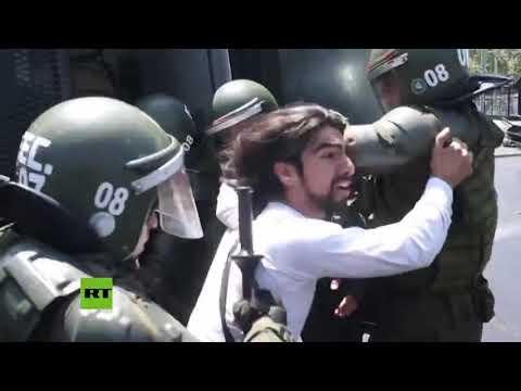 RT en Español: Protestas en Chile terminan en enfrentamientos con la Policía y detenciones