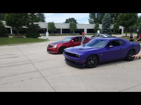 20 roll Procharged Scatpack vs Modded CTS-V