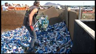 Behind the Bars of Full Throttle recycling beer cans, Sturgis,SD