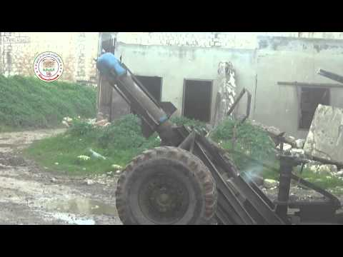 FSA destroys buildings with Hell Canon.