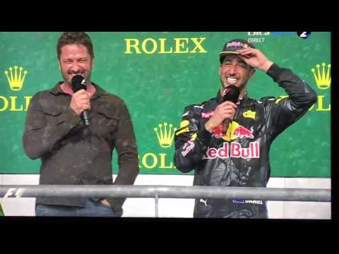 Gérard Butler drinks Red Bull from Daniel Ricciardo shoe F1 Austin :)