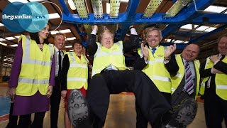 Boris Johnson does pull-ups on Routemaster bus chassis
