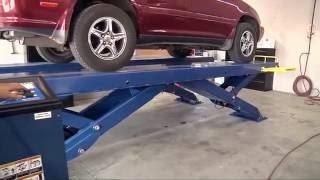 Scissor Car Lift from BendPak: XR-12000 Quatra Automotive Shop Installation Raising a Lexus