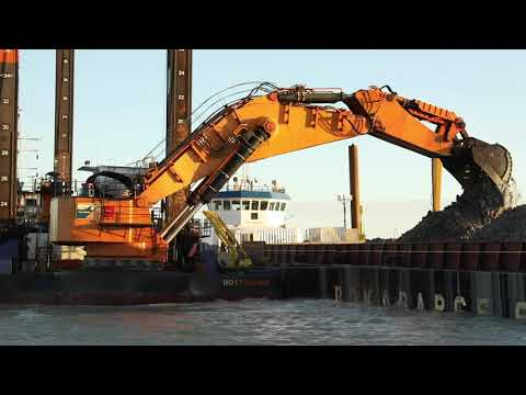 """Backhoe dredger """"Simson"""" in operation for construction of the work harbour"""