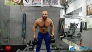 Жим Арнольда с гирями - техника выполнения упражнения