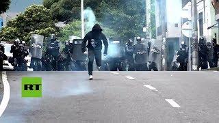 Estudiantes y policía se enfrentan en huelga estudiantil en Colombia