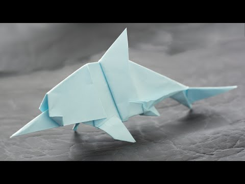 Ichthyosaur from paper. Paper reptile. Origami dinosaurs