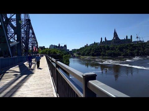 Walking across the Alexandra Bridge between Ottawa and Gatineau (Canada)