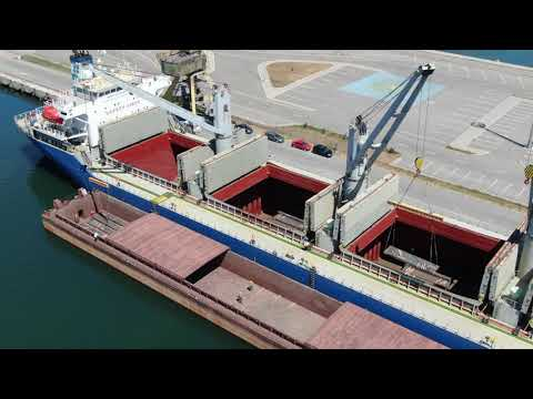 Steel slabs transshipped from vessel to barge, UMEX Terminal