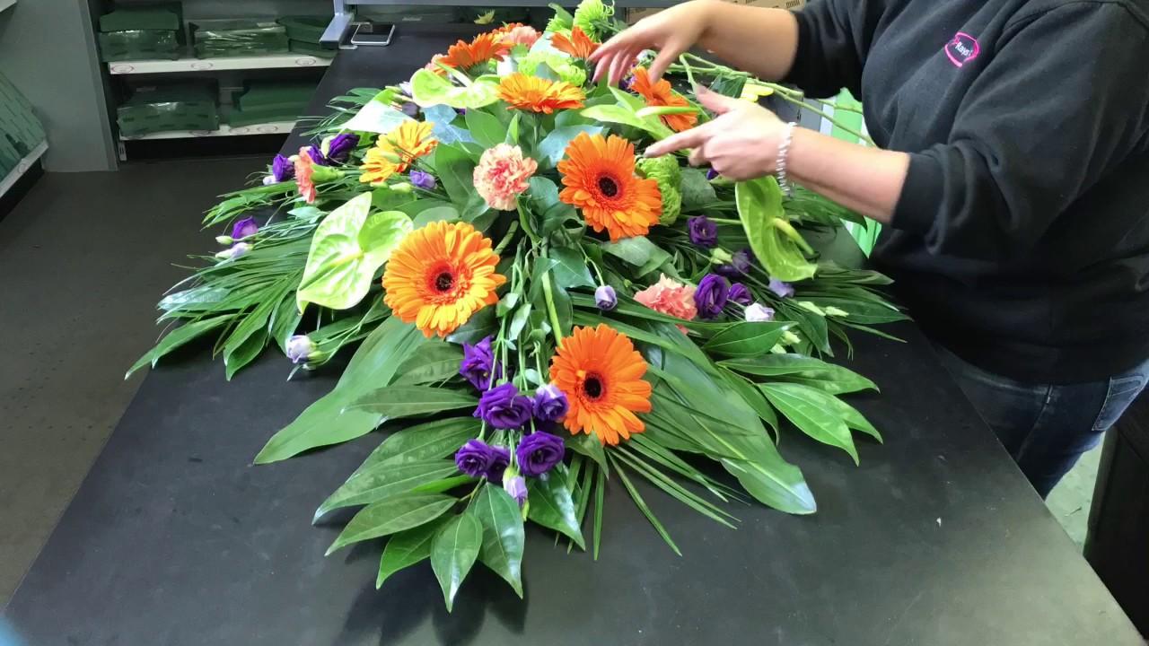 1aa871d9404c87 Vibrant Casket Spray Funeral Flowers Time Lapse