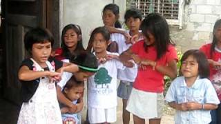 Kids in the Philippines sing